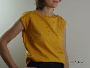 gelbes T-Shirt mit grauen Punkten