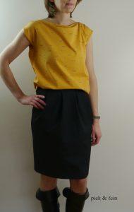 grauer Tulpenrock und gelbes T-Shirt