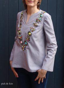 sommerliche Tunika mit aufgenähtem Perlenband